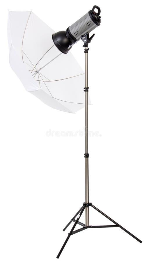Studio strobe light flash with umbrella stock photos
