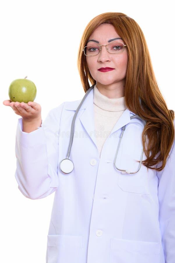 Studio strzał kobiety lekarki mienia zieleni jabłko fotografia royalty free