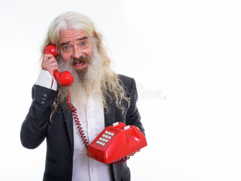 Studio strzał szczęśliwy starszy brodaty biznesmena ono uśmiecha się, rozmowa i zdjęcie stock