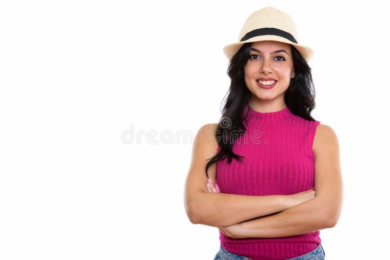 Studio strzelał młoda szczęśliwa Hiszpańska kobieta ono uśmiecha się podczas gdy będący ubranym h zdjęcia stock