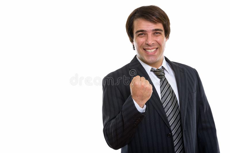 Studio strzelał młody szczęśliwy Perski biznesmen ono uśmiecha się podczas gdy kibel obraz stock