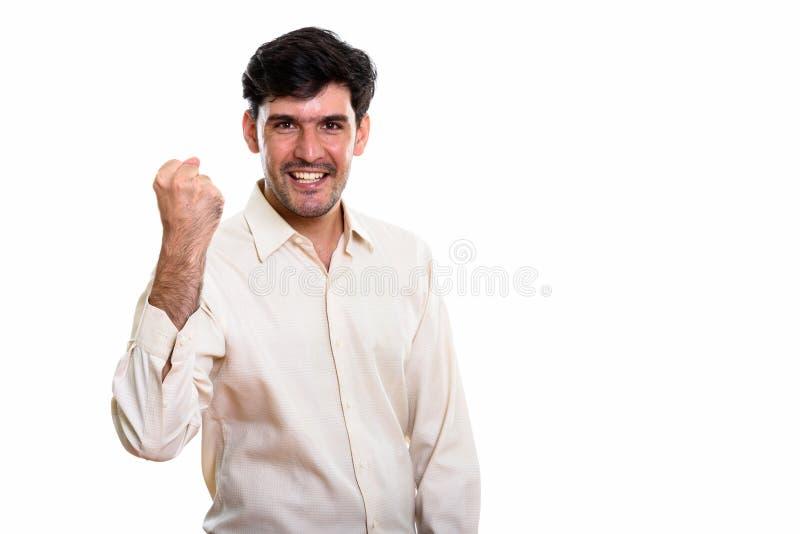 Studio strzelał młody szczęśliwy Perski biznesmen ono uśmiecha się podczas gdy kibel obrazy royalty free