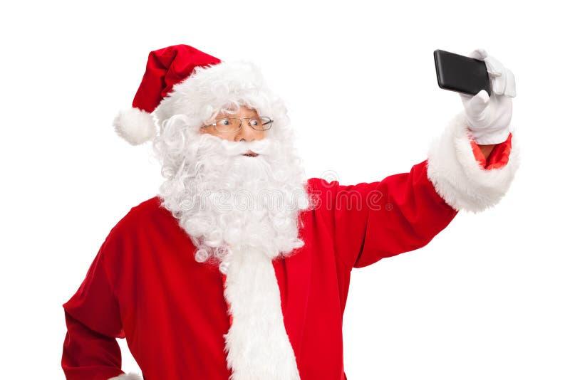 Studio strzelający Święty Mikołaj bierze selfie zdjęcia stock