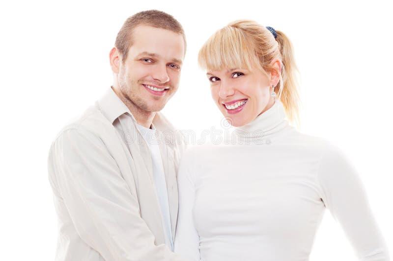 Studio tiré des couples souriants images libres de droits