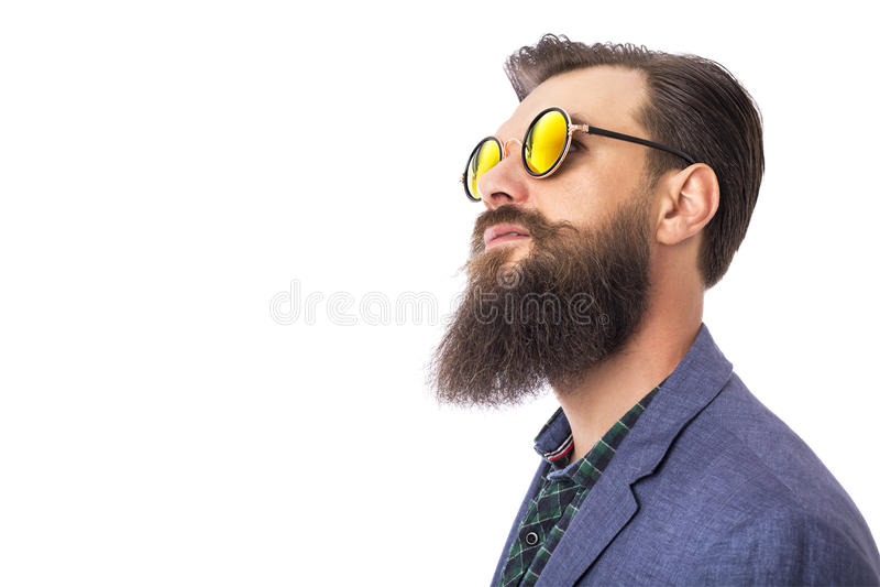 Studio van een knappe modieuze mens met baard wordt geschoten die stock afbeeldingen