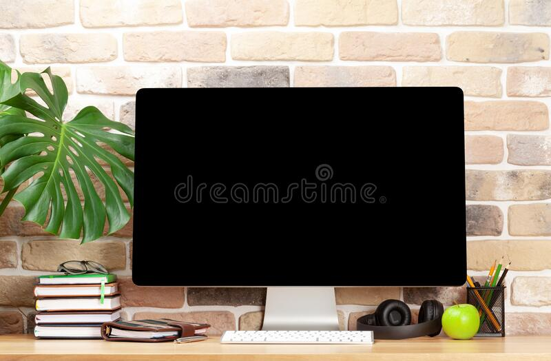 Studio workspace with desktop computer, supplies and apple. With copy space for your text royalty free stock photos