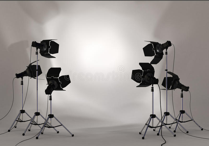 Studiobelysningstrålkastare på väggen royaltyfria foton