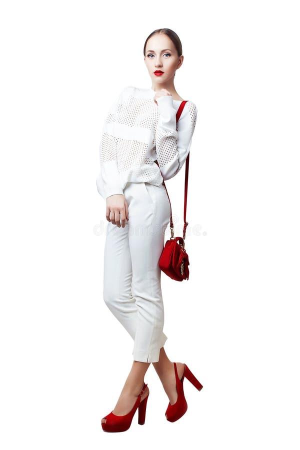 Studiofoto av den unga kvinnan på isolerad vit bakgrund arkivbild