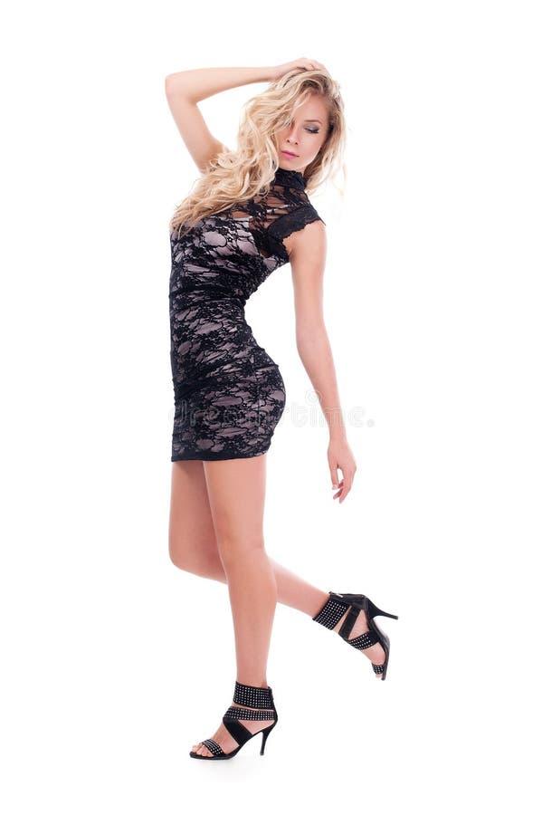 Studiofoto van een mooi meisje op een witte achtergrond stock foto