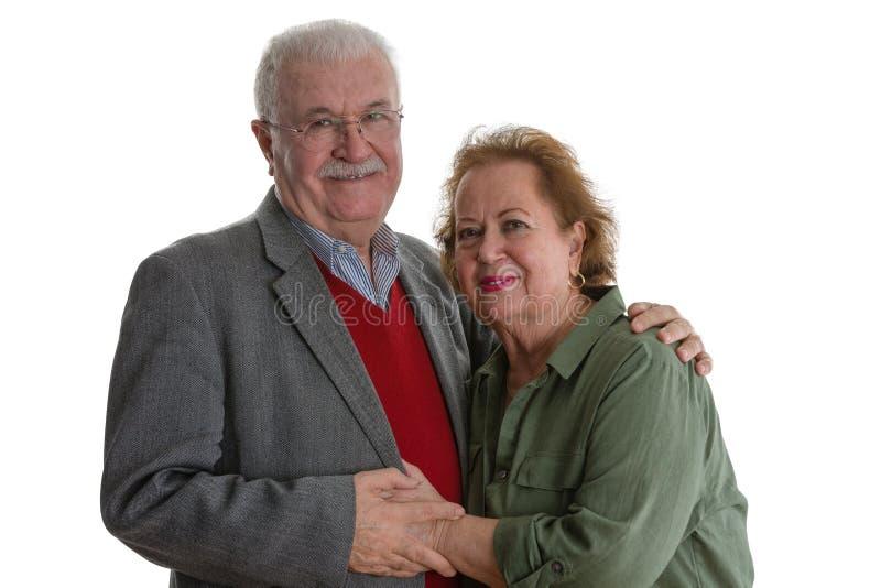 Studioporträt von lächelnden älteren Paaren stockbilder