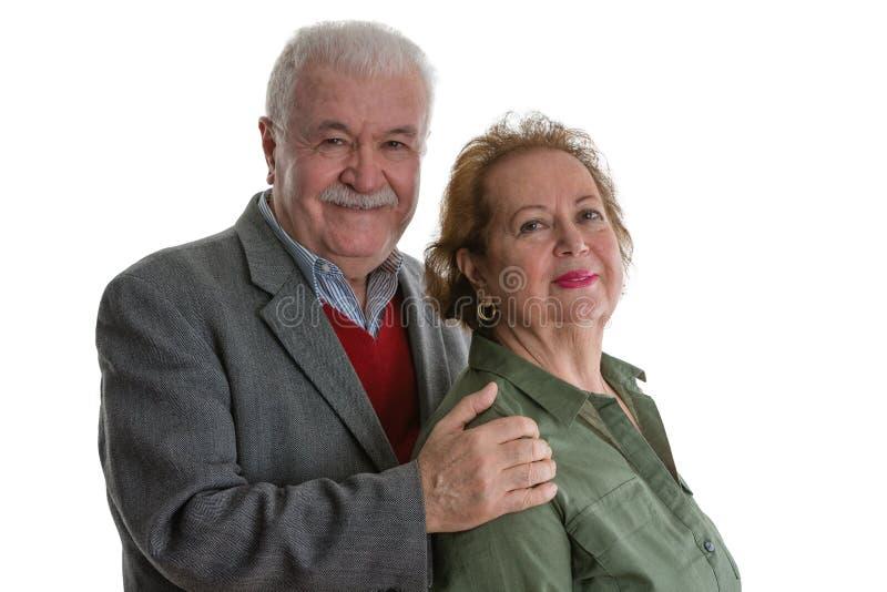 Studioporträt von netten älteren Paaren stockfotos