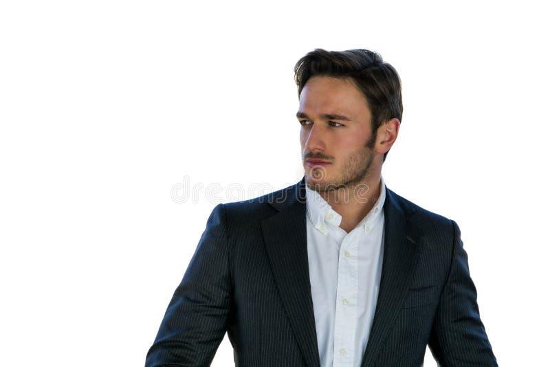 Studioportret van aantrekkelijke jonge zakenman stock foto