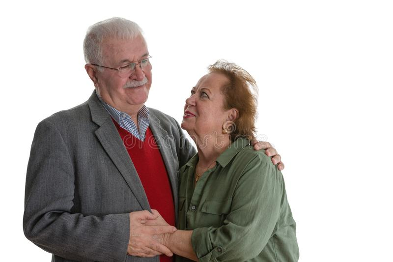Studioportret van glimlachend bejaard paar stock foto's