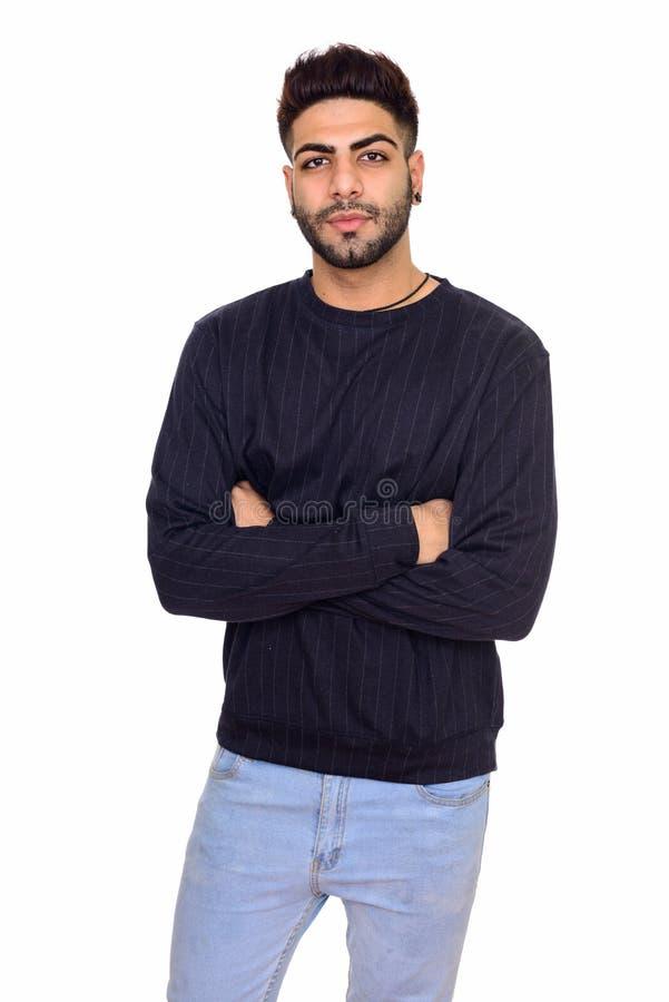 Studioschot van de jonge knappe Indische mens met wapens gekruiste isola stock foto