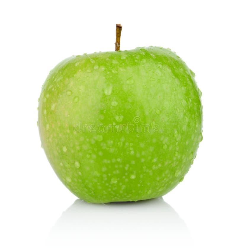 Studioskott av det hela nya gröna äpplet som isoleras på en vit bakgrund fotografering för bildbyråer