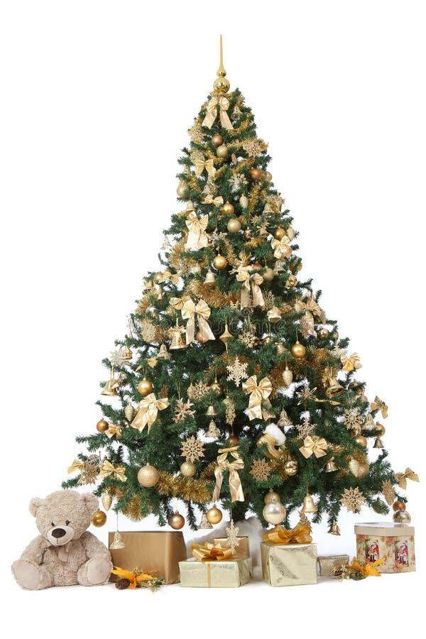 Studioskott av ett rikt dekorerat julträd med guld- orange fotografering för bildbyråer
