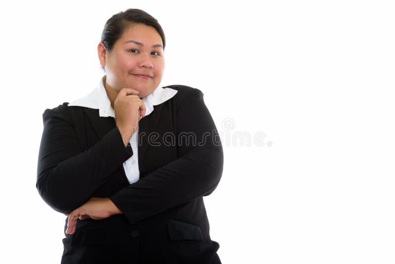 Studioskott av ungt fett asiatiskt tänka för affärskvinna fotografering för bildbyråer