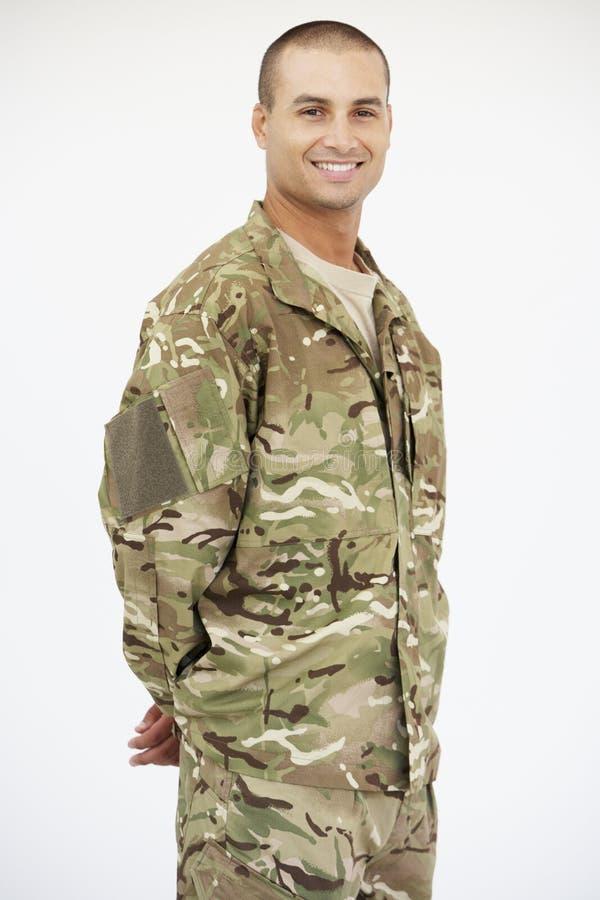 Studiostående av soldaten Wearing Uniform royaltyfri foto