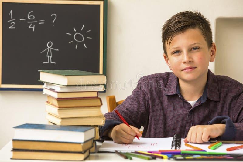 Studious schoolboy doing homework. Education. Studious schoolboy doing homework. Preparation for exams stock photo