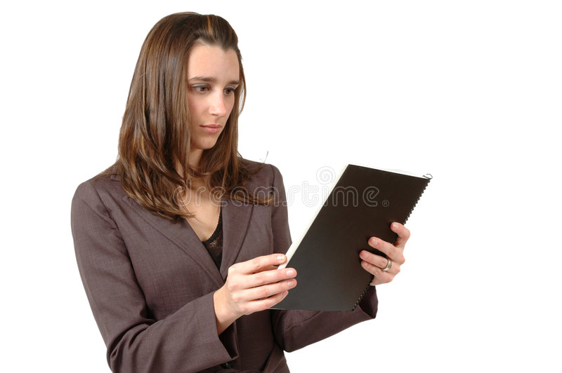 Study. Business woman or student studies the report in front of her seriously stock images
