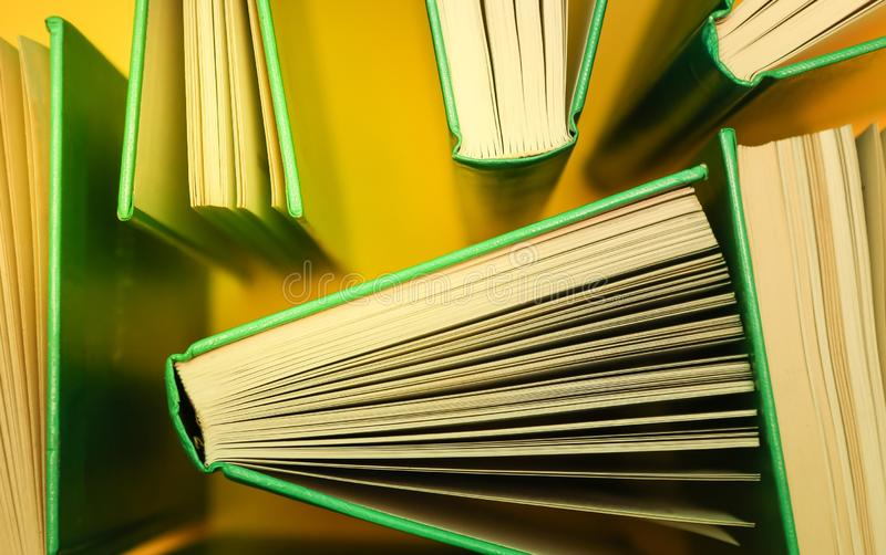 Study books, literature shot from above - Books on yellow. stock photography