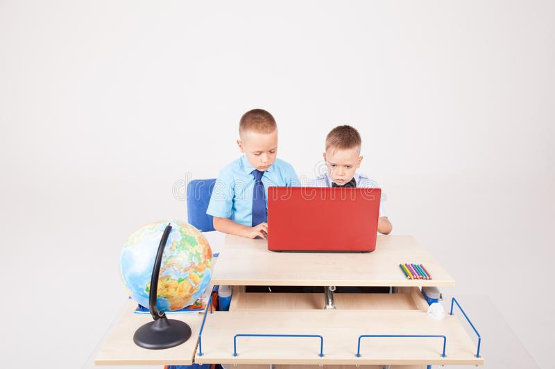 Study on the computer two boys at school royalty free stock photo