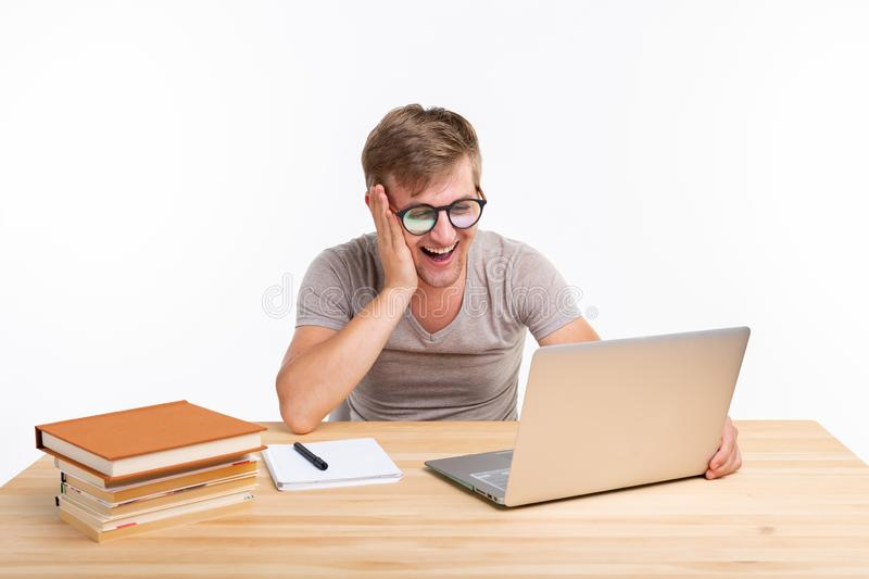 Study, education, people concept - man doing exercises in laptop, looking amazed royalty free stock image