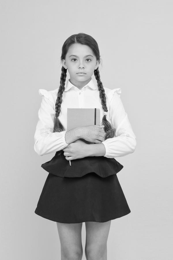 Study foreign language. Essay for homework. KId girl student likes to study. Study literature. Private lesson. Adorable. Child schoolgirl hold copybook. Formal stock photos