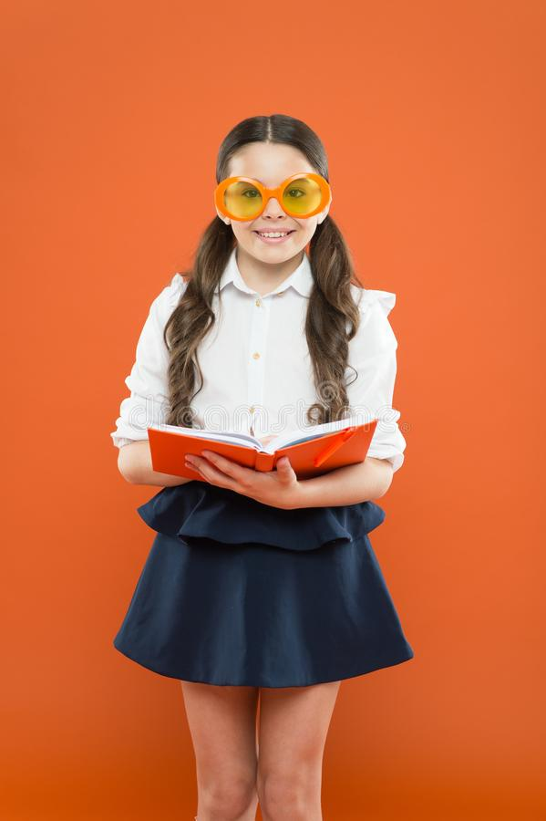 Study foreign language. Study literature. Pupil likes study. The more you know the more you grow. Small girl enjoying. Her school time. Happy little schoolgirl royalty free stock image