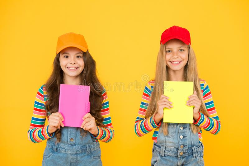 Study group can help solidify and clarify material. Kids girls with books study together. Back to school. Learning. Foreign languages. Effective study groups stock photos