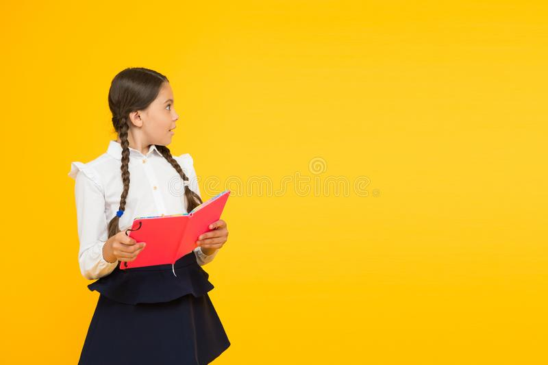 Study language. Study at home. Cute child study with textbook. Practice and improve reading skills for school studies stock photos