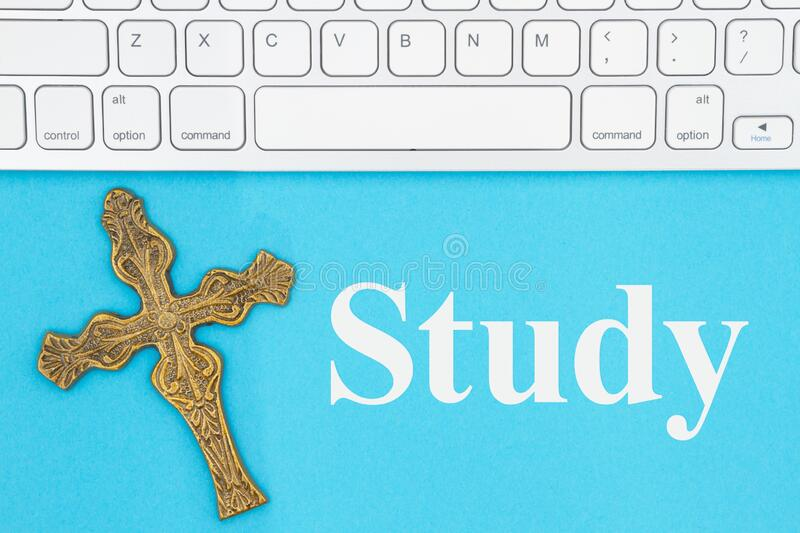 Study message with gray keyboard with a religious cross stock image