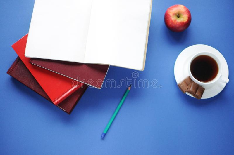 Study stuff. Education background. Stationery. Aspects of education. Food for brain. Pencil, opened notebook, books, an apple, cof royalty free stock photo