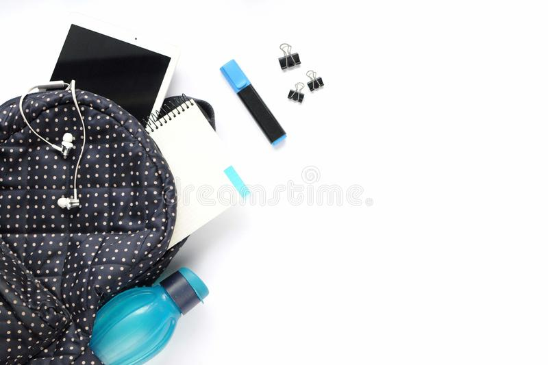 Study stuff. Education background. Stationery. Aspects of education. Stickers, marker, clips, headphones, bagpack, tablet, bottle royalty free stock photo