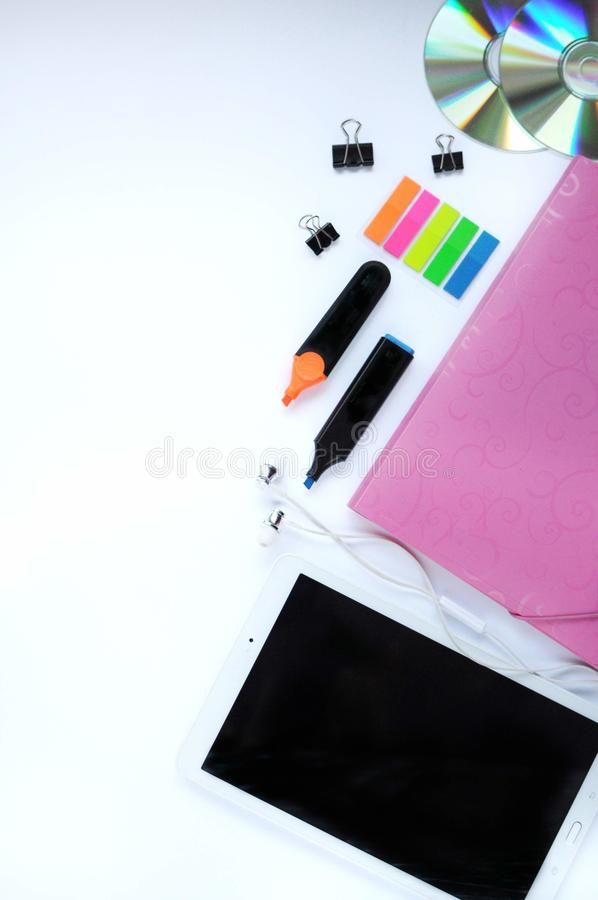 Study stuff. Education background. Stationery. Aspects of education. Stickers, tablet, markers, cd-discs, folder, headphones, clip stock images