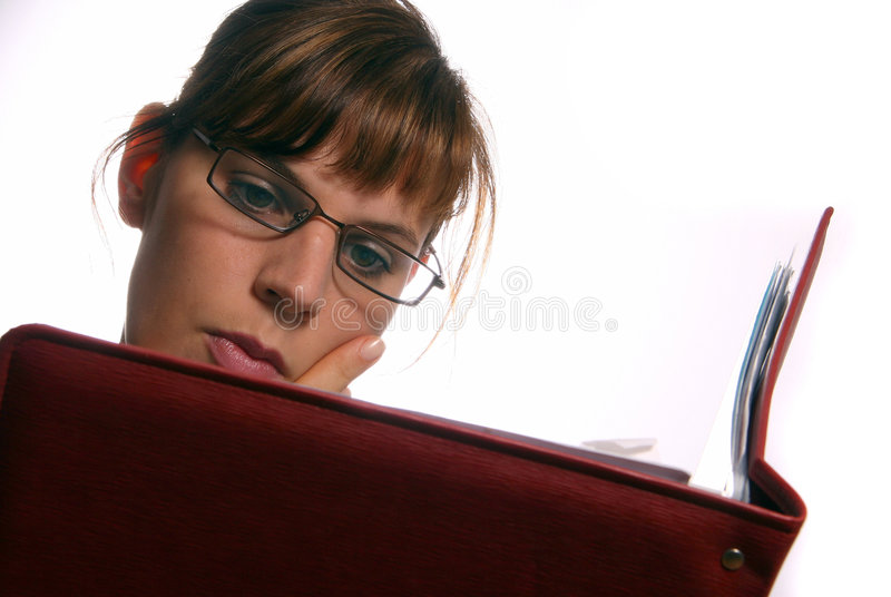 Studying. A young woman is learning hard for a test stock photos