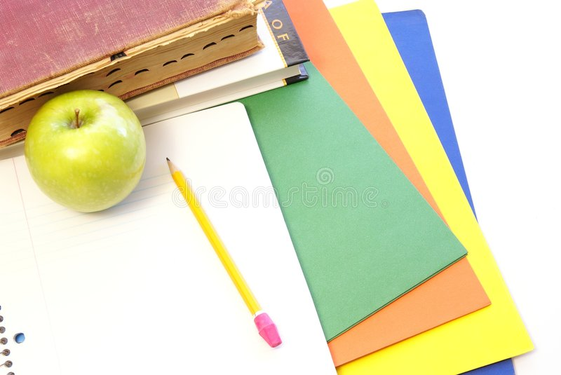 Studying. School supplies and studying concept with dictionary, notebook, pencil, and folders royalty free stock image