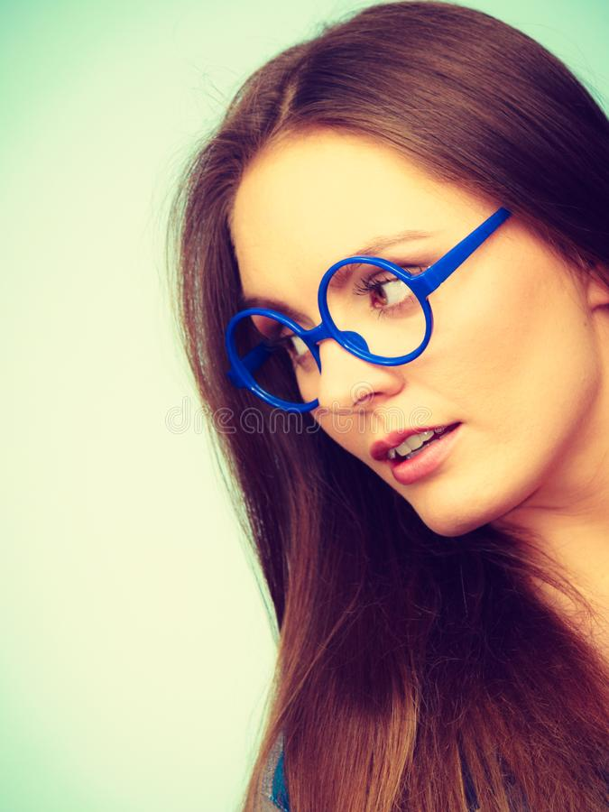 Attractive nerdy woman in weird glasses royalty free stock photos