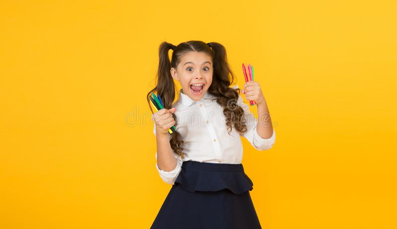 Studying creativity. Happy little student preparing markers for studying drawing on yellow background. Cute small child. Studying art in school. Studying is fun royalty free stock photos