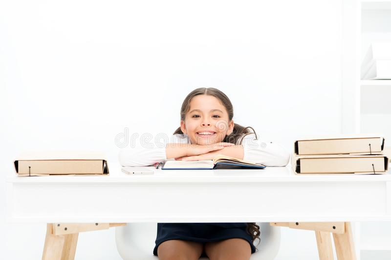 Studying on desk with incorrect height can lead back pain. What should be height of study table. Schoolgirl doing. Homework at table. Adorable pupil little girl stock photography
