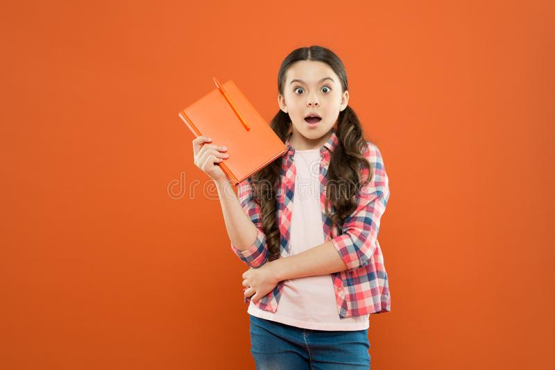 Studying is exciting. Girl cute kid study with book. Interesting book. Did you know. Pupil with work book. Literature. And writing lesson. Schoolgirl with royalty free stock images