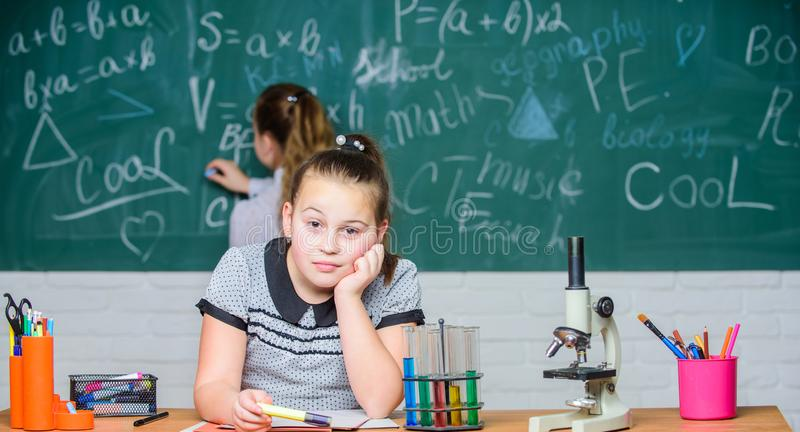 Studying hard. Biology science. Happy little girls. Chemistry research. science experiments in laboratory. Little girls royalty free stock images