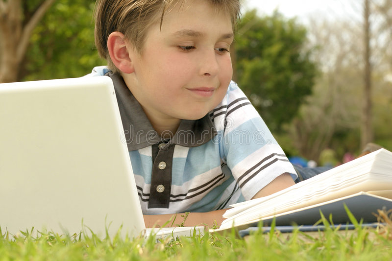 Download Studying Or Reading In The Park Stock Image - Image of child, parkland: 242015