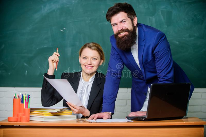 Studying together is fun. teacher and student on exam. businessman and happy secretary. business couple use laptop and royalty free stock photography
