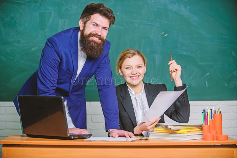 Studying together is fun. teacher and student on exam. businessman and happy secretary. business couple use laptop and stock photo