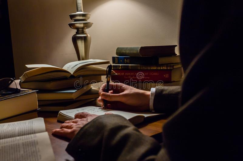 Studying works of literature on a crowded desk stock photography