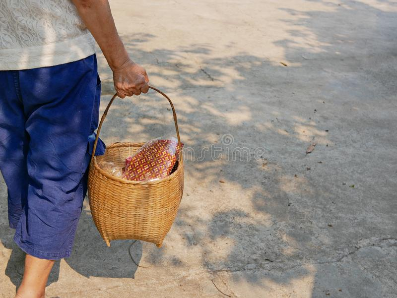 Stuff in a basket being carried for Rod Nam Dam Hua ceremony, paying respect to the elders, during Songkran festival in Thailand. Stuff in a basket being carried stock images