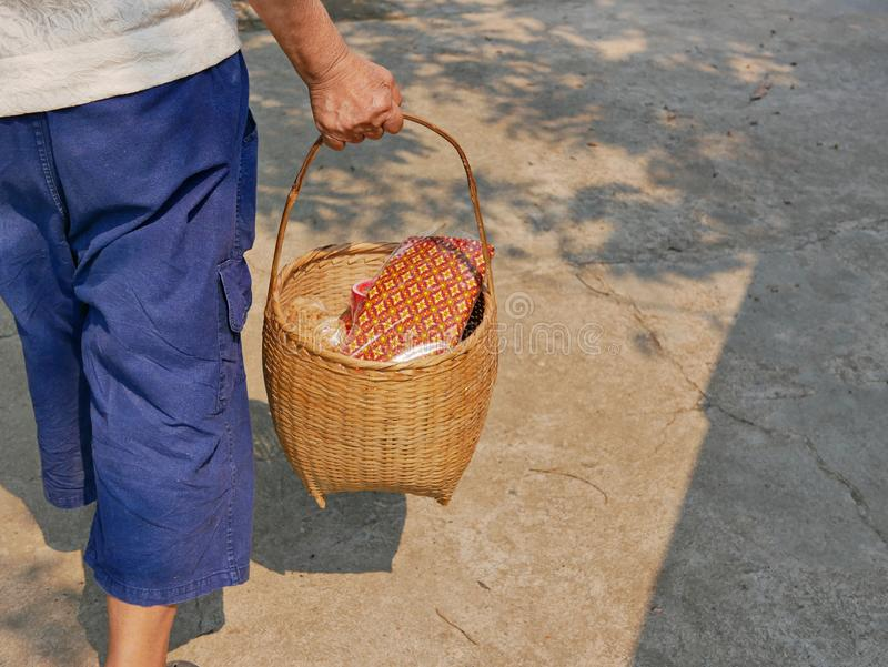 Stuff in a basket being carried for Rod Nam Dam Hua ceremony, paying respect to the elders, during Songkran festival in Thailand. Stuff in a basket being carried stock photos