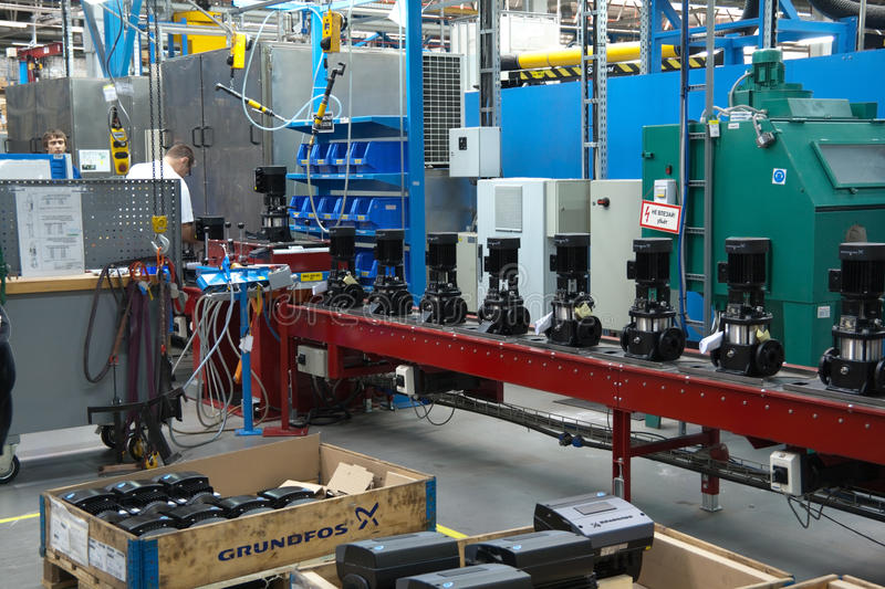 Stuff at conveyor with fabricated pumps on a plant