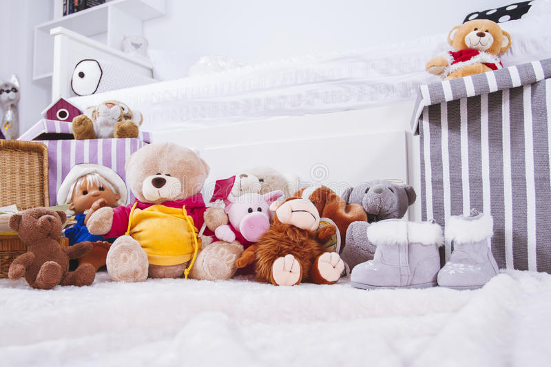 Stuffed animal toys in interior room stock image